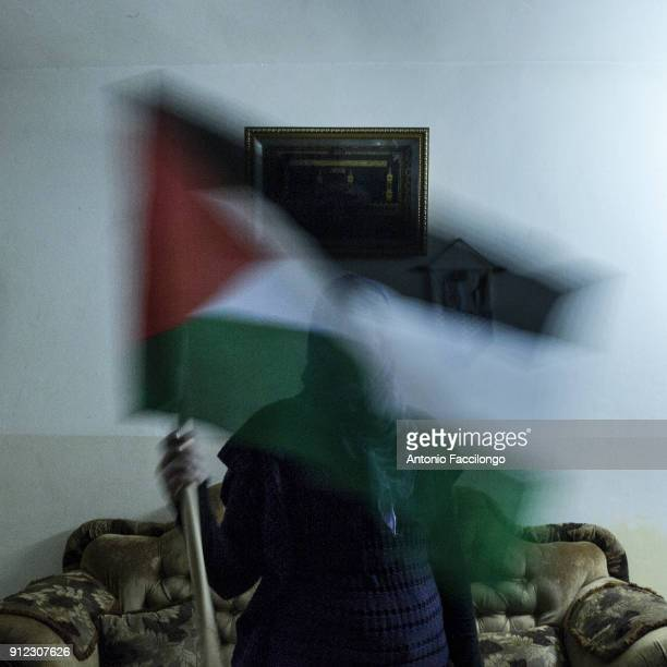 Palestine Jericho A woman shows the Palestinan flag This is the story of Palestinian prisoners'u2019 wives who have turned to sperm smuggling in...