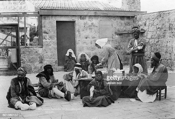 hospital for people suffering from lepra they are cared for by a European nurse probably in the 1910s