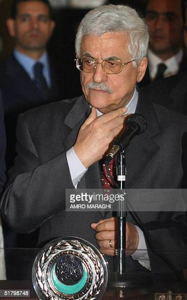 Palestine Liberation Organisation Chairman Mahmud Abbas attends a press conference in Cairo 28 November 2004 Following meetings with Egyptian...
