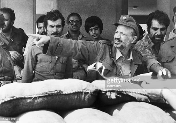 Palestine Liberation Organization chairman Yasser Arafat gives directions to soldier during battles in Beirut with the Israeli Army in 1982.