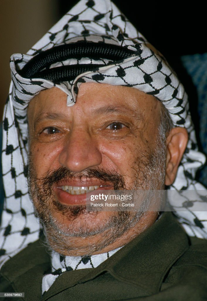 Palestine Liberation Organization leader Yasser Arafat attends the 19th session of the Palestinian National Council. The PLO proclaimed the state of Palestine, acknowledged resolutions 181, 242, and 338, and condemned terrorism during the meeting.