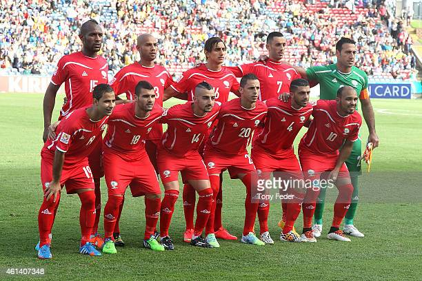 Palestine players line up before the match during the 2015 Asian Cup match between Japan and Palestine at Hunter Stadium on January 12 2015 in...
