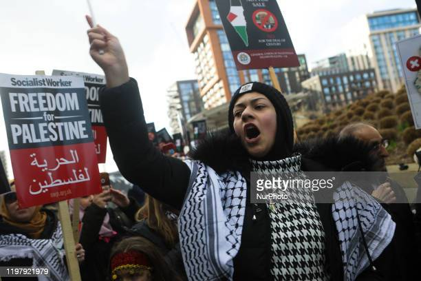 Palestine supporters gather outside the American Embassy as a protest is held against the proposed peace deal for the Middle East by President Donald...