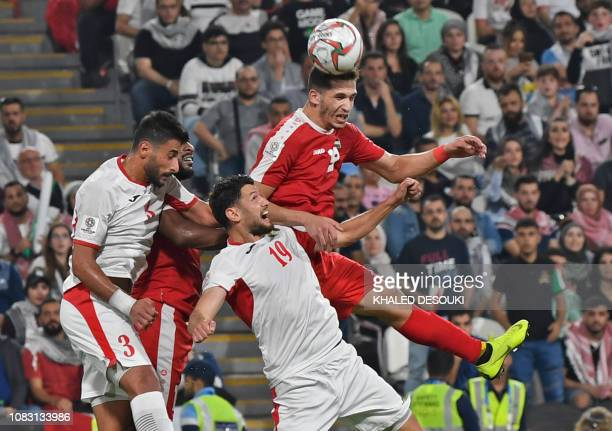 Palestine's forward Mahmoud Wadi vies for the header with Jordan's defender Anas Bani Yaseen during the 2019 AFC Asian Cup group B football match...