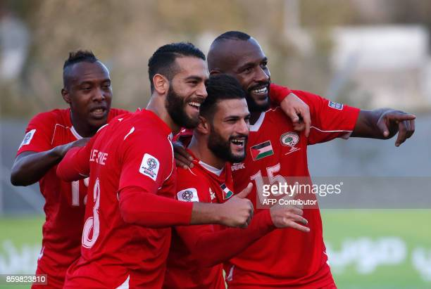 Palestine's players celebrate after scoring a goal during the Asian Cup 2019 qualifier football match between Bhutan and Palestine on October 10 in...