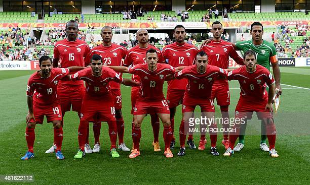 Palestine's team poses for a photograph during the Group D Asian Cup football match between Palestine and Jordan in Melbourne on January 16 2015 USE