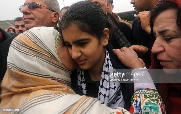 Palestinian 14yearold schoolgirl Malak alKhatib is greeted by relatives after her release from an Israeli jail on February 13 in the West Bank...