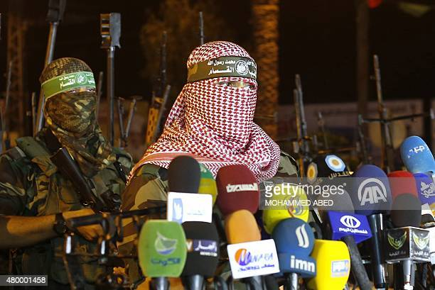 Palestinian Abu Obeida spokesman of Hamas's armed wing the AlQassam Brigades delivers a statement in Gaza City late on July 8 2015 Israel and...