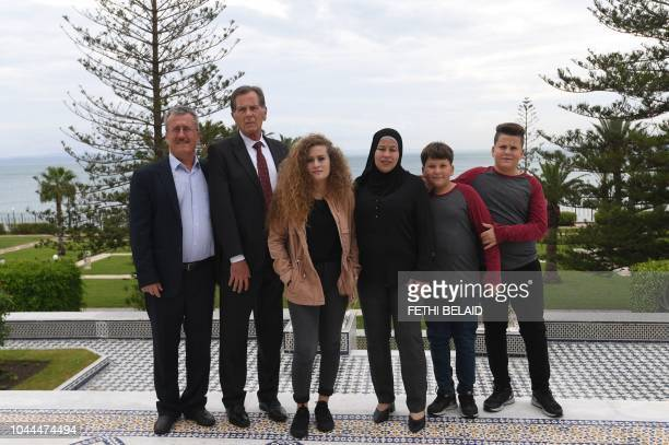 Palestinian activist Ahed Tamimi poses for a picture with her family in Carthage presidential palace before meeting with the Tunisian president on...