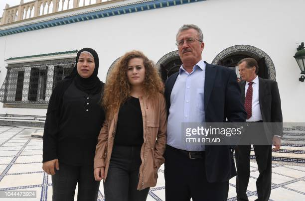 Palestinian activist Ahed Tamimi poses for a picture with her parents in Carthage presidential palace before meeting with the Tunisian president on...