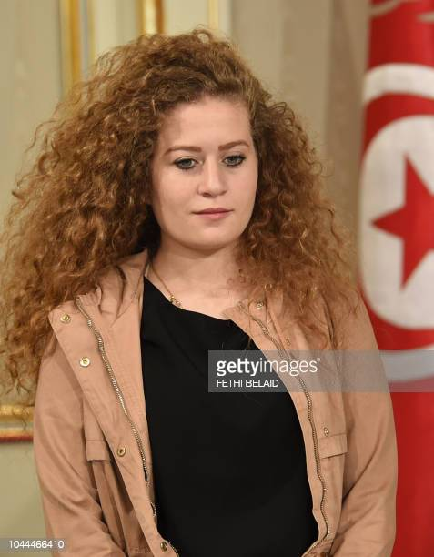 Palestinian activist Ahed Tamimi stands as she waits to meet with the Tunisian President in the capital Tunis on October 2 2018 Tamimi a teenager who...