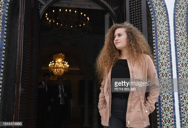Palestinian activist Ahed Tamimi stands in Carthage presidential Palace before her meeting with the Tunisian president on October 2 in the capital...
