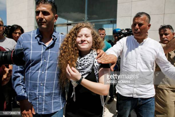 Palestinian activist and campaigner Ahed Tamimi arrives at the mausoleum of former Palestinian leader Yasser Arafat in Ramallah in the occupied West...