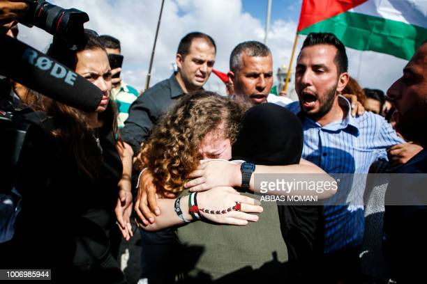 Palestinian activist and campaigner Ahed Tamimi embraces a woman upon her release from prison after an eightmonth sentence for slapping two Israeli...