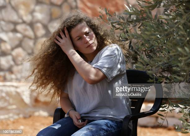 Palestinian activist and campaigner Ahed Tamimi gestures during an interview with Agence FrancePresse in the West Bank village of Nabi Saleh on July...