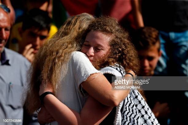 TOPSHOT Palestinian activist and campaigner Ahed Tamimi is hugged by her Israeli lawyer Gaby Lasky in the West Bank village of Nabi Saleh on July 29...