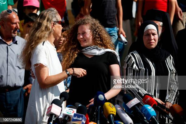 Palestinian activist and campaigner Ahed Tamimi is hugged by her Israeli lawyer Gaby Lasky in the West Bank village of Nabi Saleh on July 29 upon her...