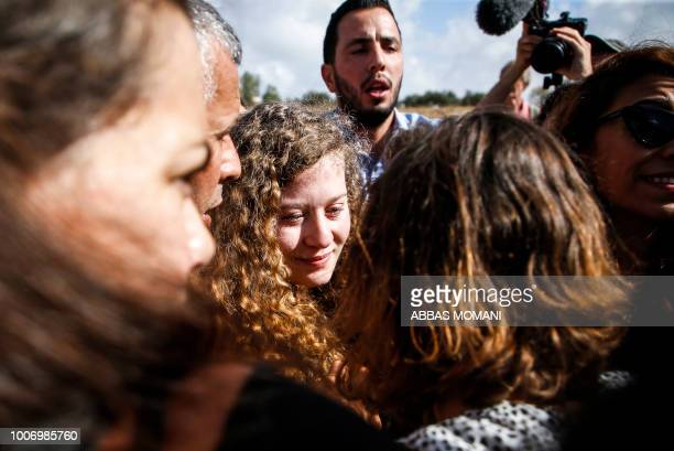 Palestinian activist and campaigner Ahed Tamimi is seen upon her release from prison after an eightmonth sentence for slapping two Israeli soldiers...