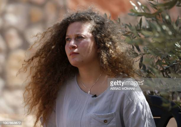 Palestinian activist and campaigner Ahed Tamimi listens during an interview with Agence FrancePresse in the West Bank village of Nabi Saleh on July...