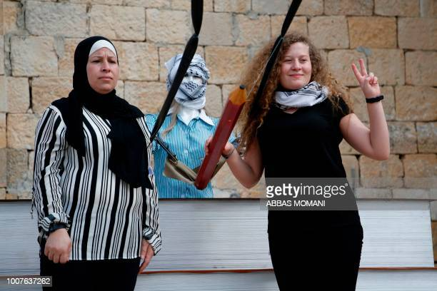 Palestinian activist and campaigner Ahed Tamimi poses for a picture with her mother Nariman after a press conference in the West Bank village of Nabi...