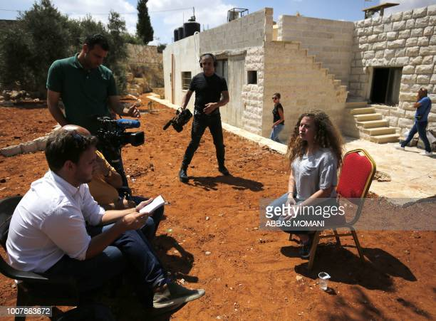 Palestinian activist and campaigner Ahed Tamimi seated speaks during an interview with Agence FrancePresse in the West Bank village of Nabi Saleh on...