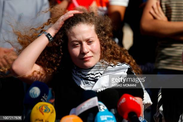 Palestinian activist and campaigner Ahed Tamimi speaks during a press conference in the West Bank village of Nabi Saleh on July 29 upon her release...
