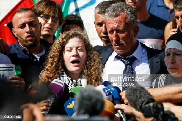 TOPSHOT Palestinian activist and campaigner Ahed Tamimi speaks to reporters upon her release from prison after an eightmonth sentence for slapping...
