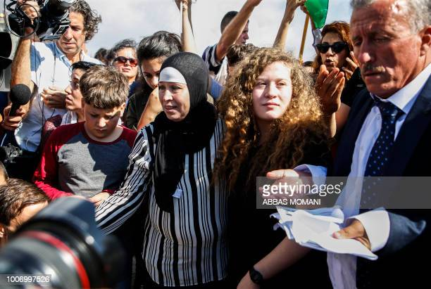 TOPSHOT Palestinian activist and campaigner Ahed Tamimi stands alongside her father mother and brother upon her release from prison after an...