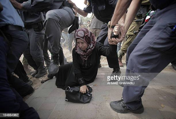 A Palestinian activist is arrested by Israeli border police as dozens of Palestinians block the entrance to branch of the Rami Levy supermarket...