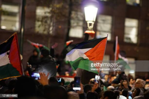 palestinian activists in bruxelles against trump recognition of jerusalem as israel capital - palestinian stock pictures, royalty-free photos & images