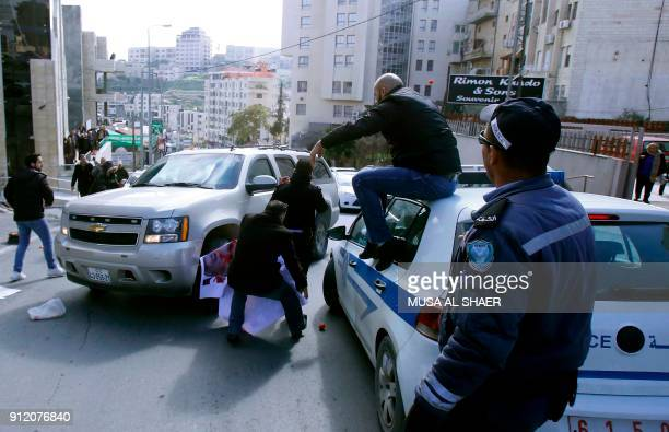 Palestinian activists throw tomatoes at a vehicle transporting members of an American economic delegation that are meeting with the Head of the...