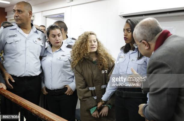 TOPSHOT Palestinian Ahed Tamimi 16yearold prominent campaigner against Israel's occupation appears at a military court at the Israelirun Ofer prison...