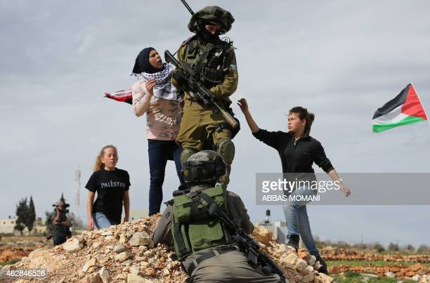Palestinian Ahed Tamimi and her mother Nariman scuffle with Israeli security forces during clashes following a demonstration in the West Bank village...