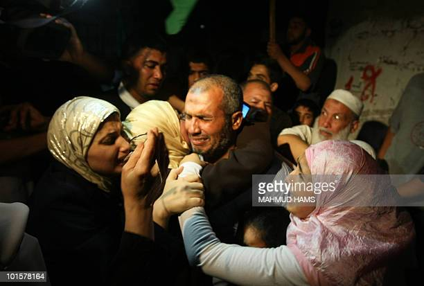 Palestinian Ahmed Dahshan who was detained with his wife aboard the Gazabound flotilla raided by Israel on May 31 is greeted by his family upon his...