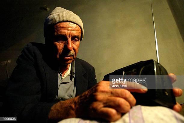 Palestinian Alhaj Abu Ramadan listens to news of the suicide attacks in Riyadh, Saudi Arabia on the radio inside his home May 13, 2003 in Gaza City,...