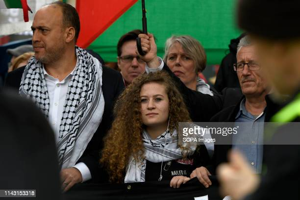 Palestinian ambassador of UK Husam Zomlot and Palestinian humans rights activist Ahed Tamimi are seen taking part during the protest Palestinian...