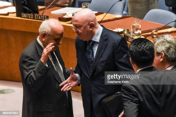 Palestinian Ambassador to the United Nations Dr Riyad H Mansour speaks with Russian Ambassador to the United Nations Vasily Nebenzya during a United...