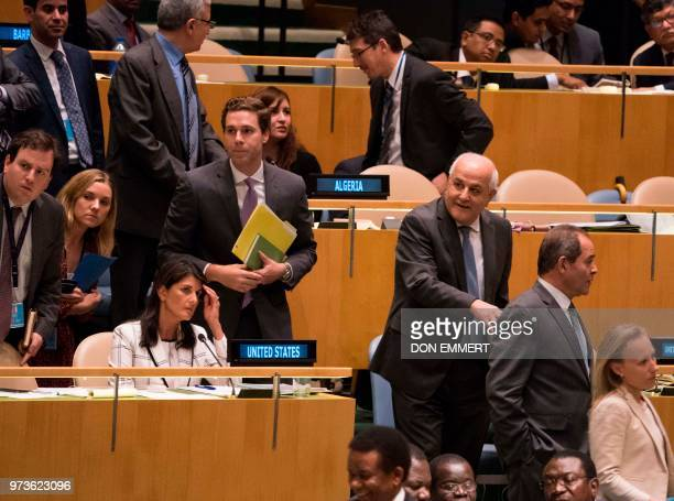 Palestinian Ambassador to the United Nations Riyad Mansour passes by US Ambassador Nikki Haley during voting to condemn Israeli actions in Gaza in...