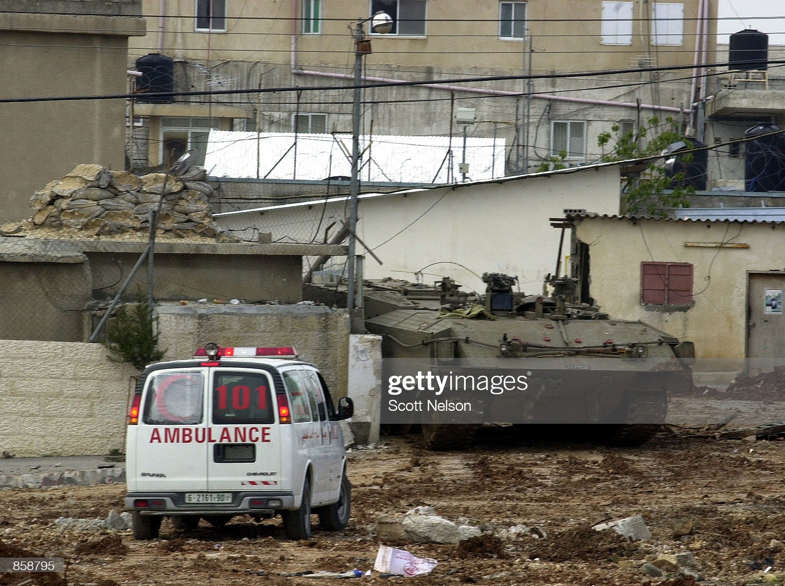 https://media.gettyimages.com/photos/palestinian-ambulance-approaches-an-armored-personnel-carrier-an-to-picture-id858795?s=2048x2048