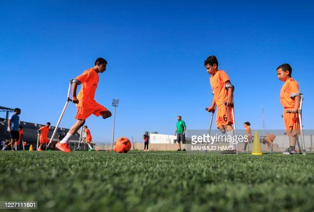 Palestinian amputee children participate in a soccer training session, arranged by the International Committee of the Red Cross after the coronavirus...