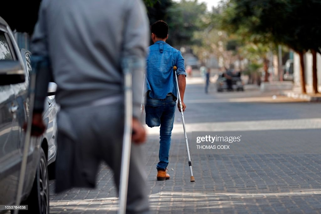 palestinian amputee men leave the icrc for artificial limbs and