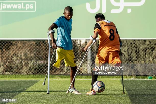 TOPSHOT Palestinian amputee soccer players take part in a training session of their team at Municipality Stadium in Deir Al Balah in the central Gaza...