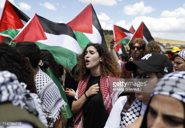 Palestinian and Arab Israeli protesters wave Palestinian flags as they march for the right of return for refugees who fled their homes or were...