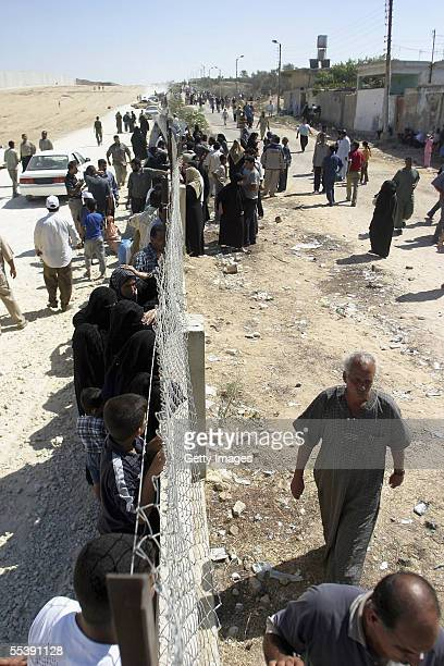 Palestinian and Egyptian people try to cross into Gaza to meet relatives September 12 2005 on the Egyptian border town of Rafah Gaza Strip Dozens of...