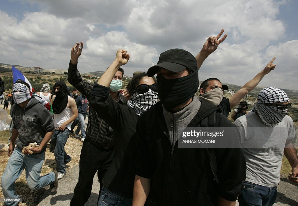 Palestinian and foreign activists take part in a demonstration against Israel�s separation barrier in the West Bank village of Bilin on April 23, 2010. US envoy George Mitchell met Israeli Defence Minister Ehud Barak, kicking off a day of talks with senior Middle East officials aimed at restarting peace negotiations.