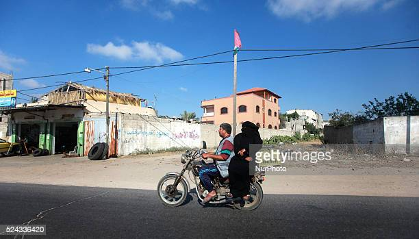 Palestinian and his wife driving a motorcycle on the road in the city of Khan Younis in southern Gaza Strip, on June 13, 2014.