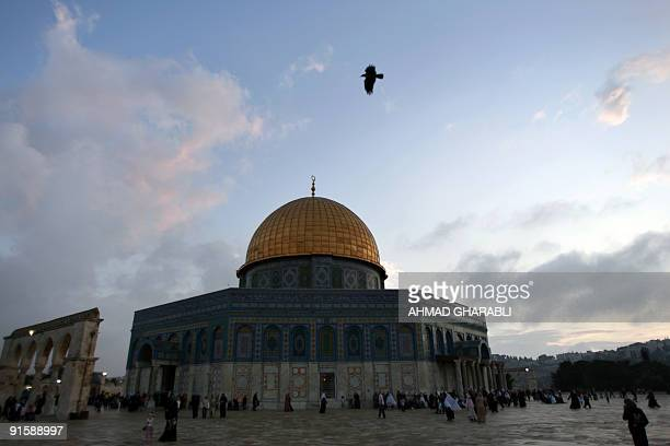 Palestinian and other Muslim worshippers arrive at the Dome of the Rock mosque in Jerusalem's AlAqsa compound to perform the early morning Eid alFitr...