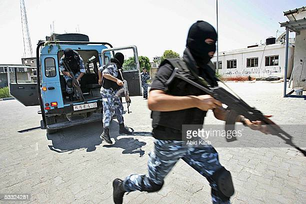 Palestinian antiriot police participate in a training session at the police headquarters on August 4 2005 in Gaza City Gaza Strip The Palestinian...