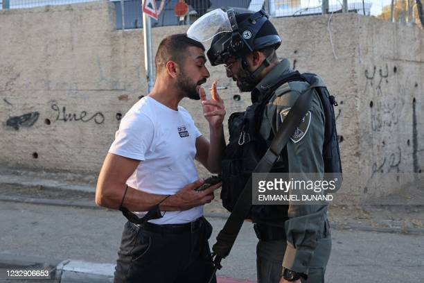 Palestinian argues with a member of Israeli security forces in the east Jerusalem neighbourhood of Sheikh Jarrah, where looming evictions of...