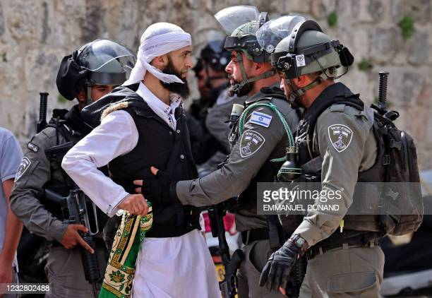 Palestinian argues with Israeli security forces in Jerusalem's Old City on May 10 ahead of a planned march to commemorate Israel's takeover of...